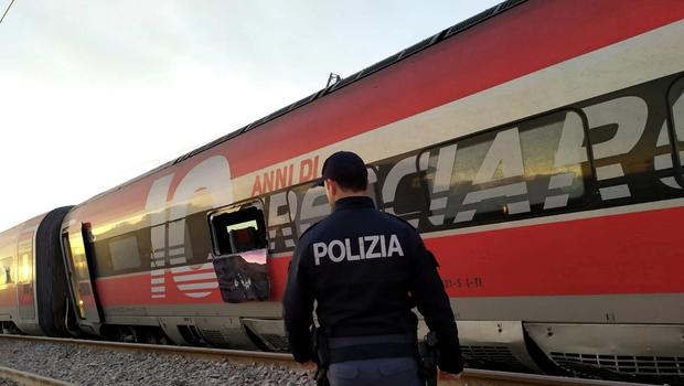 Police is seen at the scene where a high speed train travelling from Milan to Bologna derailed, in Lodi, Italy February 6, 2020. Polizia di Stato/Handout via REUTERS