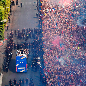 VIVE LE FRANCE: The open-top team bus with the French team goes down the Champs Elysee as the French public turn out in force to celebrate their World Cup success  Photo: AFP/Getty
