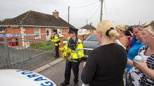 Family and friends at the scene of the house in Charleville north Cork where two twin boys where stabbed to death. Pic: Mark Condren