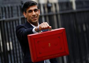 Virus action: Britain's Chancellor of the Exchequer Rishi Sunak holds the budget box in Downing Street. Photo: REUTERS/Peter Nicholls