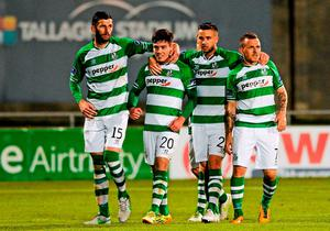 Shamrock Rovers' Brandon Miele, second from left, celebrates with teammates after scoring a late winner