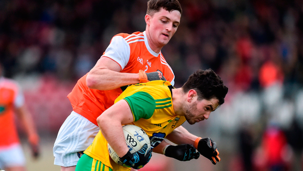 Ryan McHugh of Donegal in action against Connaire Mackin of Armagh. Photo by Oliver McVeigh/Sportsfile
