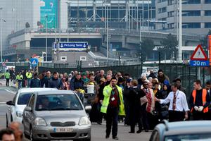 Passengers are evacuated from Brussels airport, on March 22, 2016 in Zaventem, after at least 13 people were killed and 35 injured as twin blasts rocked the main terminal of Brussels airport.AFP PHOTO / JOHN THYSJOHN THYS/AFP/Getty Images