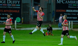Derry City's Ryan McBride, centre, celebrates after scoring his side's first goal