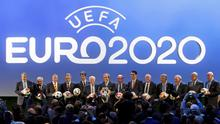 UEFA President Michel Platini (C) and delegates pose for a family photo after the announcement of the 13 cities which will host matches at the Euro 2020 tournament to be played across the continent, during a ceremony in Geneva September 19, 2014