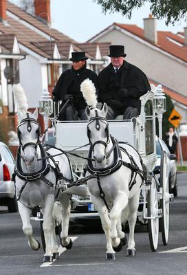 The funeral cortage of Sonia Blount pictured leaving the Holy Rosary Church, Ballycragh this morning after her funeral mass