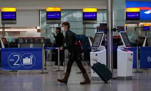 A passenger wears a face mask in Terminal 5 of Heathrow Airport, as Britons have been advised against non-essential travel to anywhere in the world as the coronavirus crisis closed borders around the globe. Photo: PA