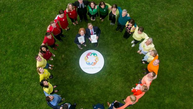 Taoiseach Enda Kenny, and Ms. Kathleen Lynch, Minister for Primary Care, Social Care, and Mental Health with mental health partner organisations and stakeholder groups in Farmleigh House. Pic: Robbie Reynolds Photography