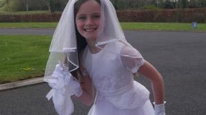 Holy smokes: Eloise McDonnell (8) ran 10km – in the dress she had for her First Communion