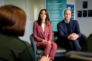 Britain's Prince William and Catherine, Duchess of Cambridge, talk with staff during a visit to the London Ambulance Service 111 control room