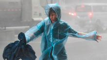 Downpour: A woman runs in a rainstorm as Typhoon Mangkhut approaches Shenzhen in China. Photo: Jason Lee/Reuters