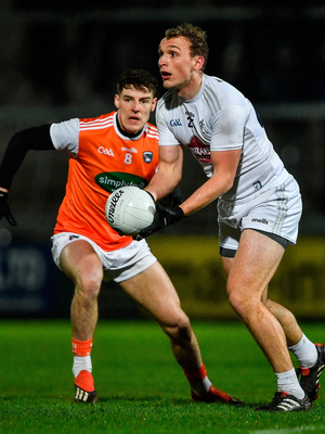 Tommy Moolick of Kildare in action against Niall Grimley of Armagh. Photo by Piaras Ó Mídheach/Sportsfile