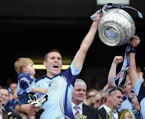 Dublin captain Ciaran Whelan celebrates with his son Jamie at the end of the game Leinster SFC final win over Wexford at Croke Park in July 2008