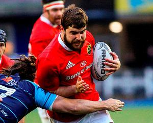 Munster's Rhys Marshall is tackled by Cardiff Blues' Josh Navidi. Photo: Darren Griffiths/Sportsfile