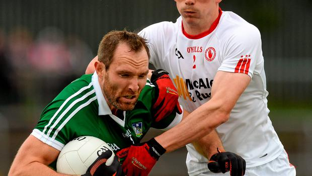 Limerick's Tom Lee in action against Tyrone's Aidan McCrory