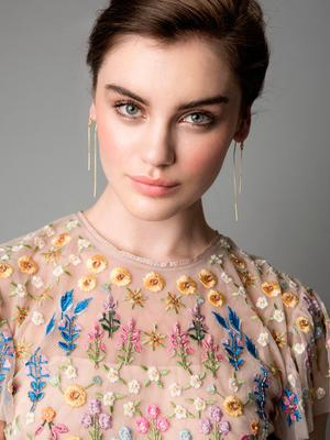 Earrings €160, Maria Black; flower embroidered top, €165, Needle & Thread