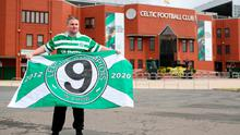 Celtic fan Jamie Rodgers holds a League Champions flag outside Celtic Park after Celtic were crowned champions of the Scottish Premiership after a decision was made to conclude the season with immediate effect