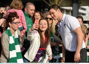 22 March 2015; Eimear McEnroe, from Ballyjamesduff, Co. Cavan, takes a photo with Jonathan Sexton after the Ireland team's arrival at Dublin Airport after beating Scotland to win the RBS Six Nations Championship. Dublin Airport, Dublin. Picture credit: Brendan Moran / SPORTSFILE