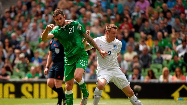 Daryl Murphy gets to the ball first ahead of Phil Jones