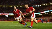 George North scores a try for Wales as captain Alun Wyn Jones cheers him on. Photo: Michael Steele/Getty Images