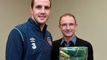 Martin O'Neill makes a presentation to John O'Shea to mark his 100th international cap. Photo: David Maher / SPORTSFILE