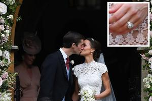 ENGLEFIELD GREEN, ENGLAND - MAY 20: Pippa Middleton kisses her new husband James Matthews, following their wedding ceremony at St Mark's Church as the bridesmaids and pageboys walk ahead on May 20, 2017 in Englefield Green, England.  (Photo by Justin Tallis - WPA Pool/Getty Images)