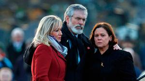 Sinn Féin's Michelle O'Neill, Gerry Adams and Mary Lou McDonald huddle at Derry City Cemetery after Martin McGuinness's funeral. Photo: Brian Lawless/PA Wire