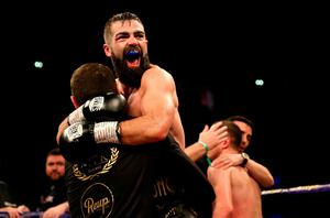 Jono Carroll celebrates victory against Scott Quigg in their Super-Featherweight contest at Manchester Arena.  Photo credit: Richard Sellers/PA Wire