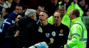HULL, ENGLAND - MARCH 03:  Hull manager Steve Bruce (2nd left)  is held back by the assistant referee as  Sunderland manager Gus Poyet (l) is sent to the stand during the Barclays Premier League match between Hull City and Sunderland at KC Stadium on March 3, 2015 in Hull, England.  (Photo by Stu Forster/Getty Images)