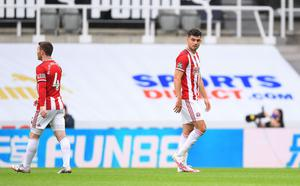 Irish defender John Egan cannot hide his disappointment after being sent off during Sheffield United's 3-0 defeat to Newcastle United. Photo: REUTERS