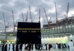 Construction cranes surround the Grand Mosque in the holy city of Mecca in this January 6, 2013 file photo as Muslim pilgrims circle the Kaaba and pray during Umrah. At least 65 people were killed when a crane crashed in Mecca's Grand Mosque on September 11, 2015, Saudi Arabia's Civil Defence authority said, in an accident that came just weeks before Islam's annual haj pilgrimage.   REUTERS/Amr Abdallah Dalsh/Files