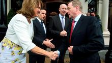 Taoiseach Enda Kenny greets Tánaiste Joan Burton at the announcement that SAS is expanding its operations in Ireland. Also pictured are Martin Shanahan, CEO of IDA Ireland (left), and John Farrelly, country manager, SAS Ireland. Photo: Tom Burke