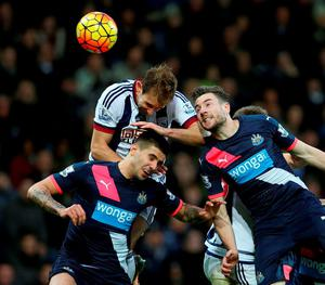 Newcastle United's Paul Dummett and Aleksandar Mitrovic challenge West Bromwich Albion's Craig Dawson. Photo: David Davies/PA Wire