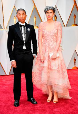 Producers Pharrell Williams (L) and Mimi Valdes attend the 89th Annual Academy Awards at Hollywood & Highland Center on February 26, 2017 in Hollywood, California.  (Photo by Frazer Harrison/Getty Images)