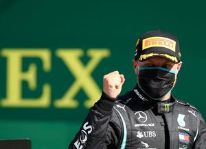 Race winner and Mercedes driver Valtteri Bottas of Finland celebrates after winning the Austrian Grand Prix at the Red Bull Ring racetrack. (Mark Thompson/Pool via AP)
