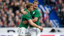Chris Henry congratulates teammate Andrew Trimble after he scored his side's second try during Ireland's game against France in the Six Nations Rugby Championship in March this year