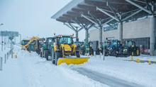 Tractors helped clear the snow from runways, taxiways and roadways at Cork Airport. Photo: Karol Kachmarsky
