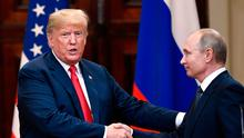 U.S. President Donald Trump and Russian President Vladimir Putin shake hands after a joint press conference at the Presidential Palace in Helsinki, Finland, Monday, July 16, 2018. (Jussi Nukari/Lehtikuva via AP)