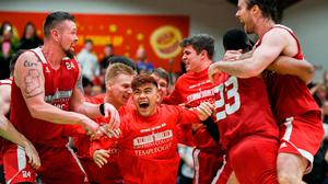 25 January 2020; Griffith College Templeogue players, including Kris Arcilla, centre, celebrate following the Hula Hoops Pat Duffy National Cup Final between DBS Éanna and Griffith College Templeogue at the National Basketball Arena in Tallaght, Dublin. Photo by Harry Murphy/Sportsfile
