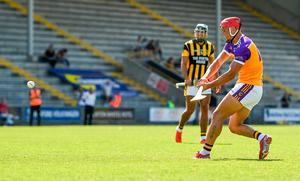 Faythe Harriers' Lee Chin hits the post from a penalty. Photo: Sportsfile