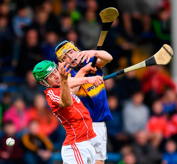 Tipperary's Conor Bowe battles with Cork's Aaron Walsh Barry. Photo: Sportsfile