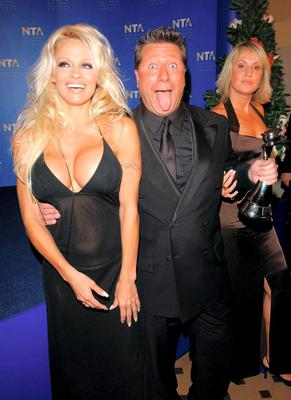 Neil Fox with Pamela Anderson and Nikki Chapman in 2002