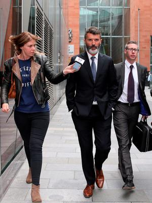Ex-Manchester United footballer Roy Keane (centre) leaves Manchester Magistrates' Court after he was cleared of aggressively confronting a taxi driver in an alleged road rage row.