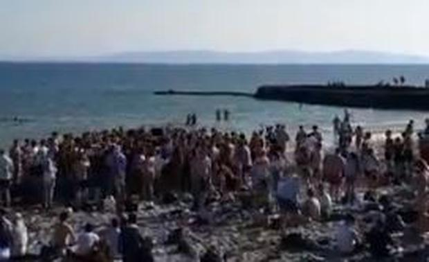 Screenshot of a video of crowds gathered Salthill, Galway yesterday.