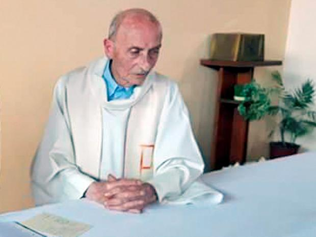 Father Jos Vanderlee, a 65-year-old priest in the north east Belgian town of Lanaken, was rushed to hospital with hand and tendon injuries. Photo: Cindy Aubree via AP