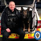 Odin with handler PC Carl Woodall Photo credit: West Midlands Police/PA Wire