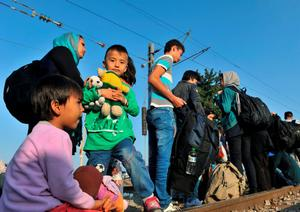 Refugees wait to cross the Greek-Macedonian border near the village of Idomeni in northern Greece