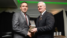 """Aogán Ó Fearghail presenting Kevin Casey with the Best GAA related Radio Programme for """"Maurice Shanahan - My Story"""" at the  2015 GAA MacNamee Awards"""