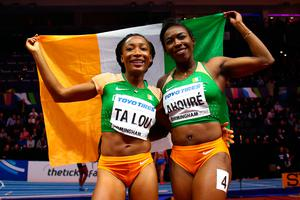 Murielle Ahoure (R) and Marie-Josee Ta Lou (L) of Cote D'Ivoire celebrate - with an Irish flag