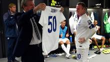Roy Hodgson, manager of England holds up an England shirt with the number 50 after Wayne Rooney broke the record of 49 goals set by Bobby Charlton during the UEFA EURO 2016 Qualifier Group E match between England and Switzerland at Wembley